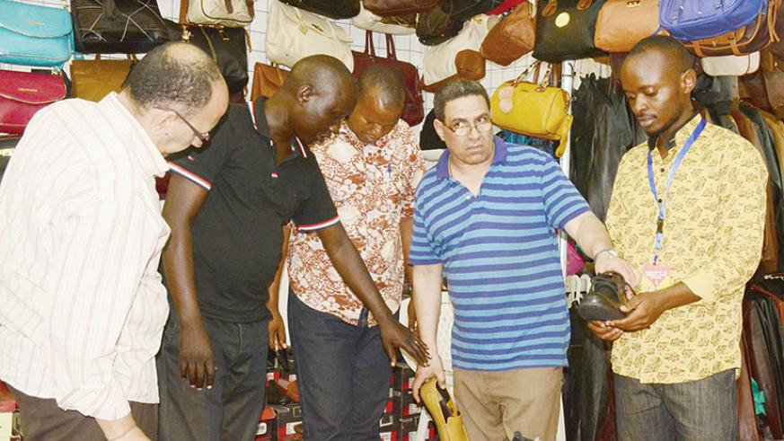 Egyptian traders at the recent Egypt and Asia expo. The traders mainly rely on locals to conduct the business during exhibitions due to language barrier constraints. Nyanza traders....
