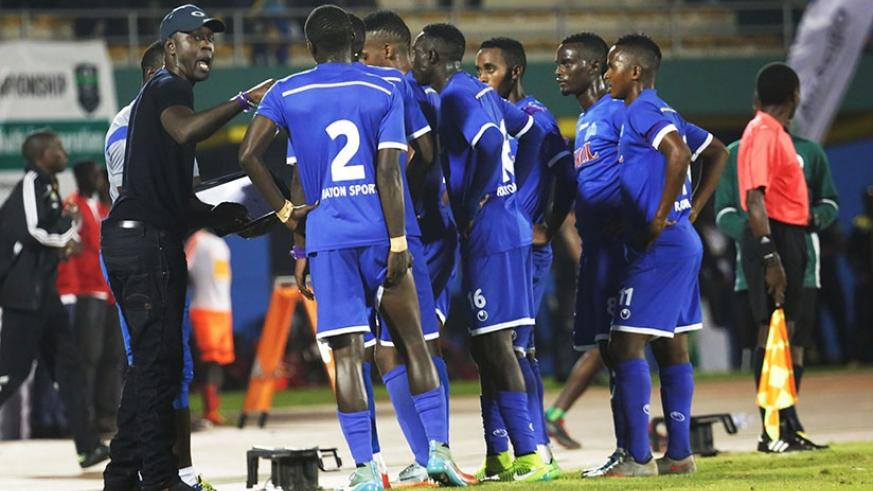Rayon Sports head coach Olivier Karekezi gives instructions to his players during the match. Samuel Ngendahimana