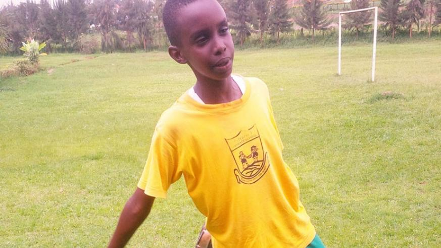 Lucky Gisa stretches after his soccer practice. / Joan Mbabazi.