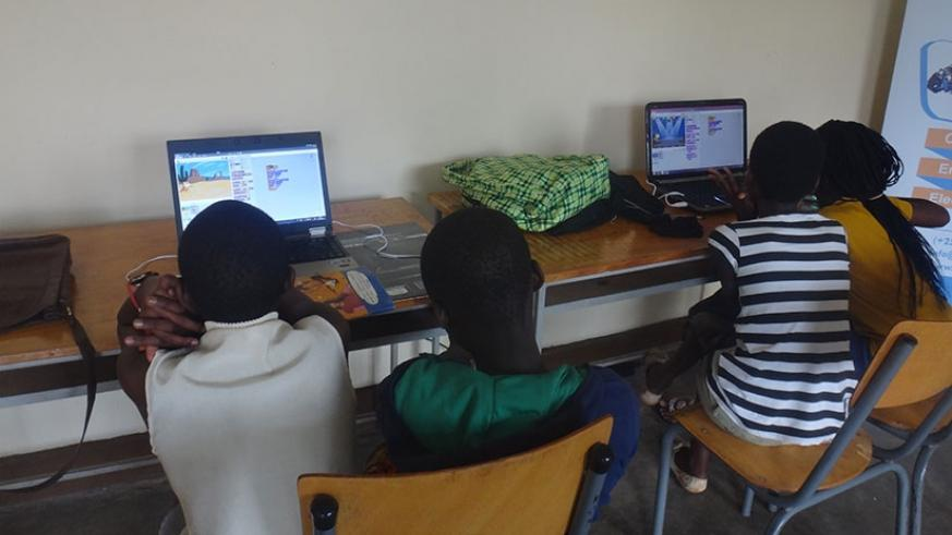 Children making computer-based animations at the creativty lab.   Inset: Some of the tools used at the Centre to introduce children to engeneering and computer science.  / Diane Mu....