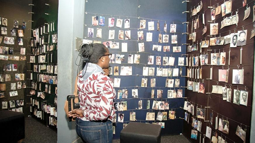 A woman looks at pictures of victims of the 1994 Genocide against the Tutsi at Kigali Genocide Memorial Centre. File.