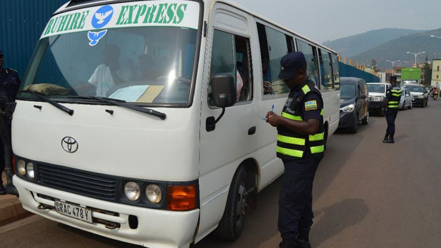 A police officer issues a ticket to a motorist who was speaking on phone while driving recently.  File photo.