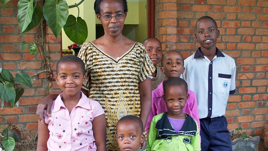 A mother with the children she raises  at SOS Children's Villages.  Circled: Some of the children on their way to school. /Courtesy photos