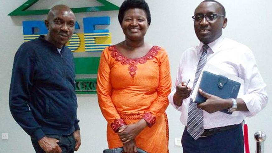 Mukanzigiye poses for a picture with RSE officials last week. / Courtesy.
