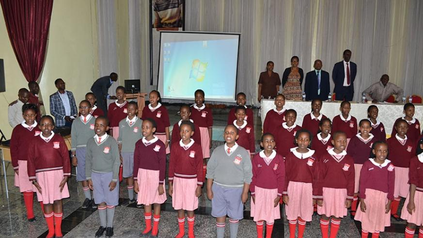 Mpeta (middle, front row) and other members of the school choir entertain guests at a school function.