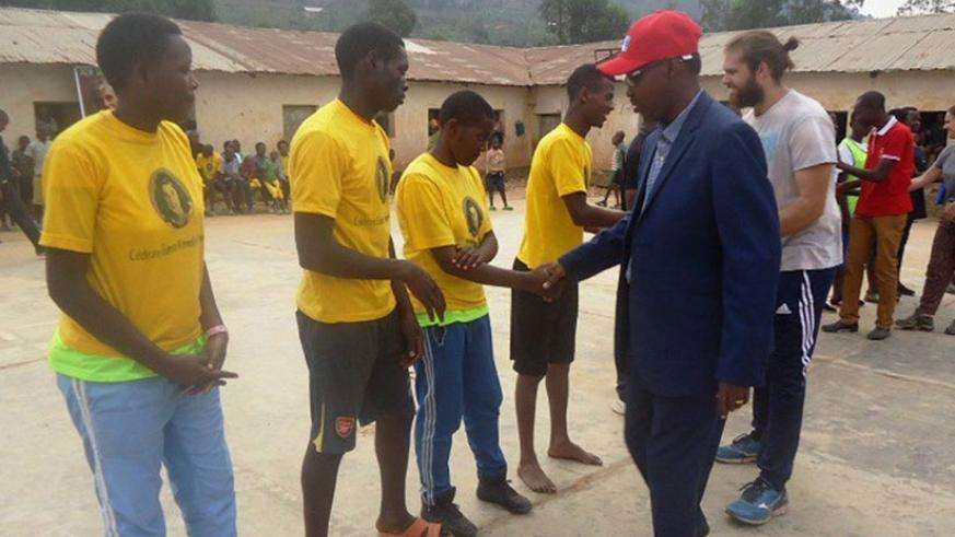 Deus Sangwa Board Chair greets some of the athletes. File