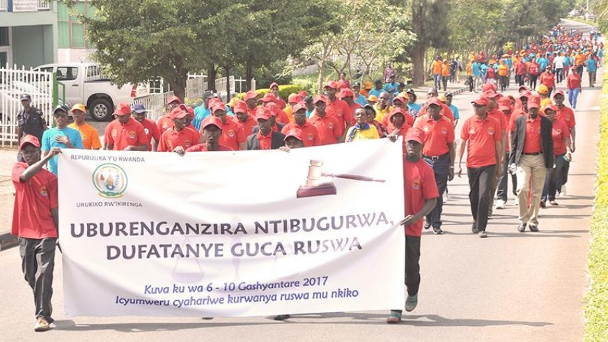 Personnel in judiciary march during the anti-corruption campaign last year. File.