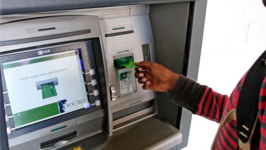 An ATM user in Kigali. File.