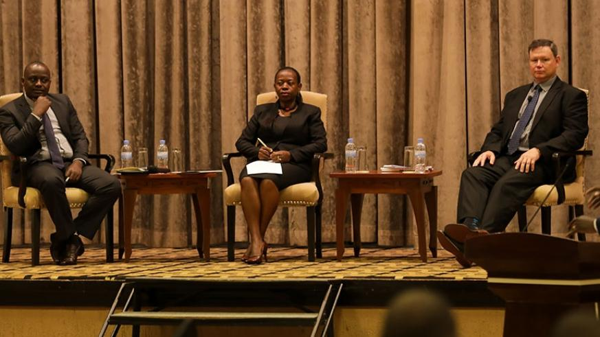 Jean Marie Nyirurugo, head of economics and financial crimes unit at the National Public Prosecution Authority (L), the Vice Governor of the central bank Monique Nsazabaganwa (C), ....