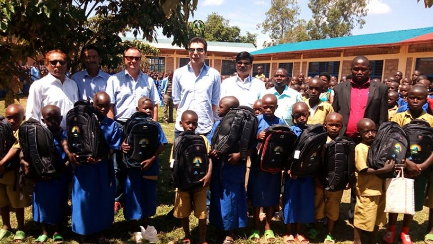 The HQ Power team with some of the 498 pupils who received the scholastic materials. (Kelly Rwamapera)