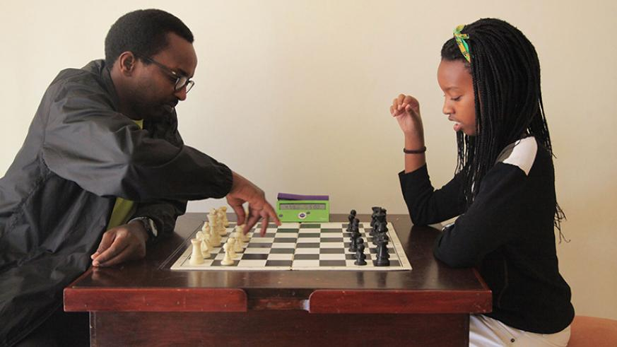 Layola Umuhoza, 14,  playing chess with her father Maxence Murara. All qualified for the 2018 Chess Olympiad. S. Ngendahimana.