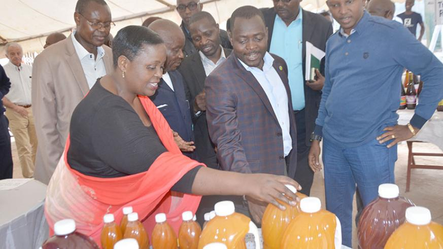 Murebwayire shows Rusizi officials some of the products at the expo. Courtesy.