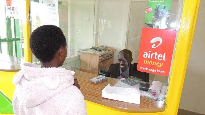 A client withdraws money from a micro-finance institution. File.