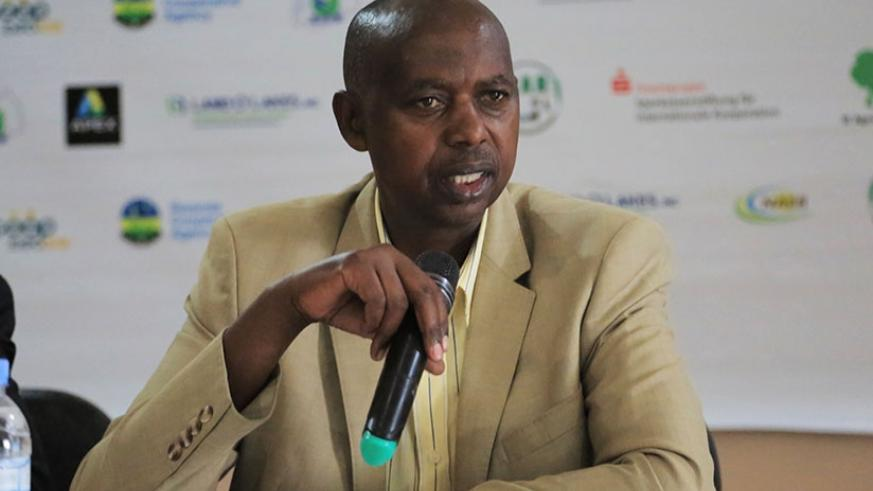Rwanda Cooperatives Agency chairman Augustin Katabarwa addresses journalists in Kigali yesterday. Sam Ngendahimana.