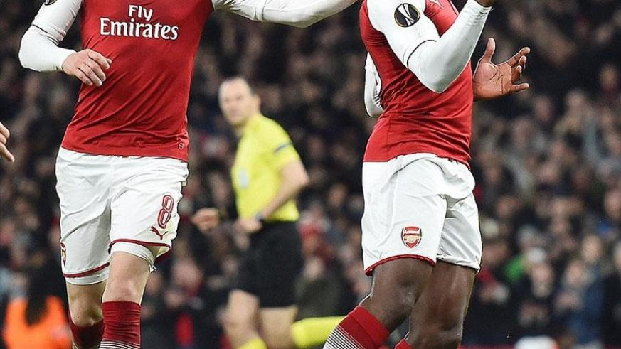 Danny Welbeck (right) celebrates the equaliser as Aaron Ramsey congratulates his Arsenal team-mate. Net photo