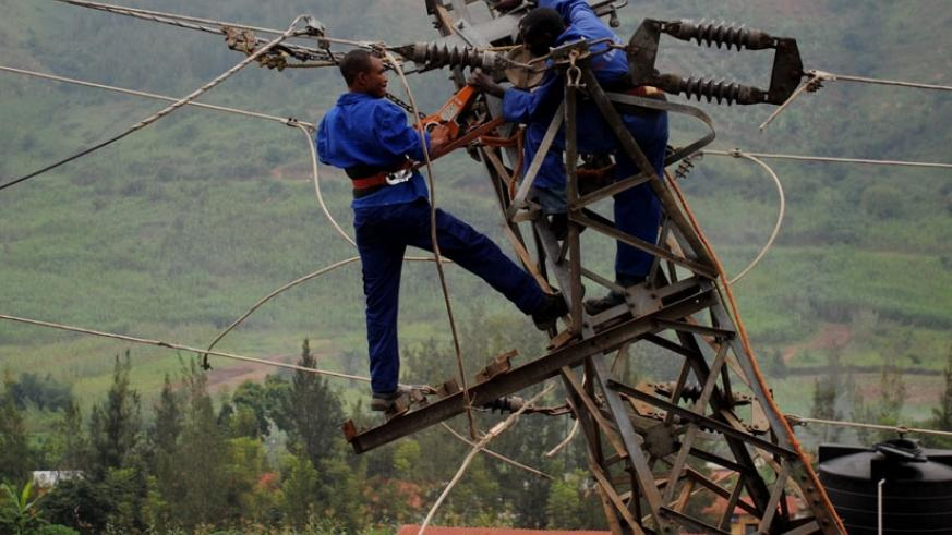 Rwanda Energy Group workers fix electric cables. File.