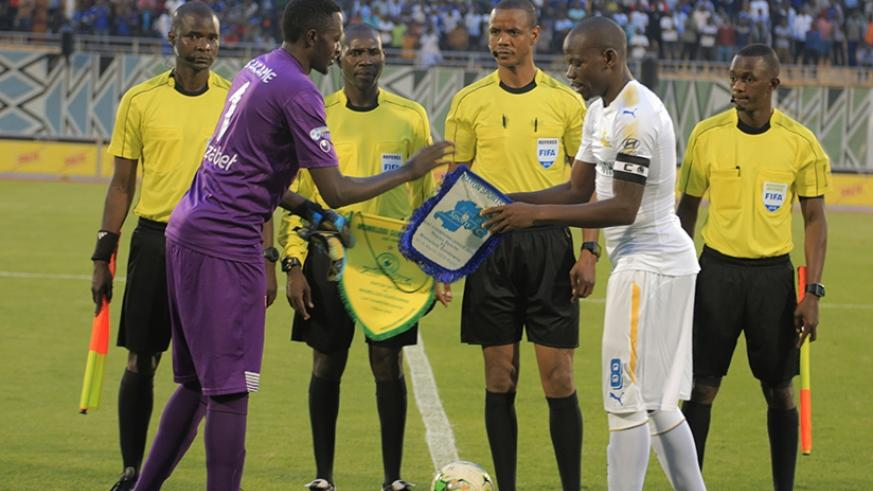Skippers Eric Ndayishimiye of Rayon Sports and his Sundowns counterpart, Kekana Hlompho exchange their teams' flag before the first leg match. S. Ngendahimana