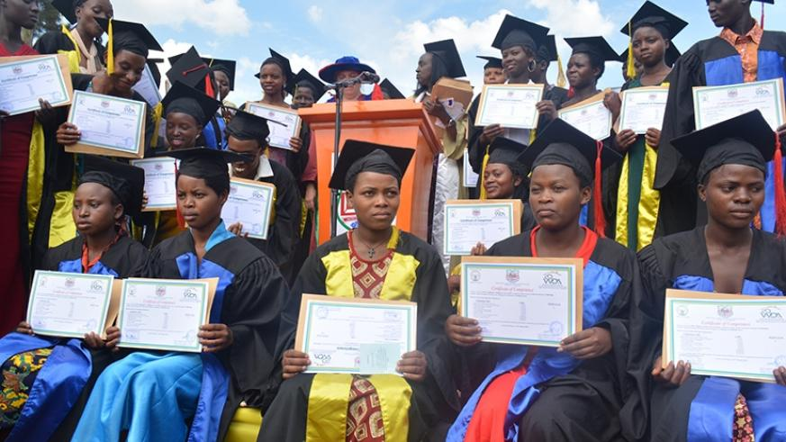 The graduates display their certificates at the ceremony. (Frederic Byumvuhore)