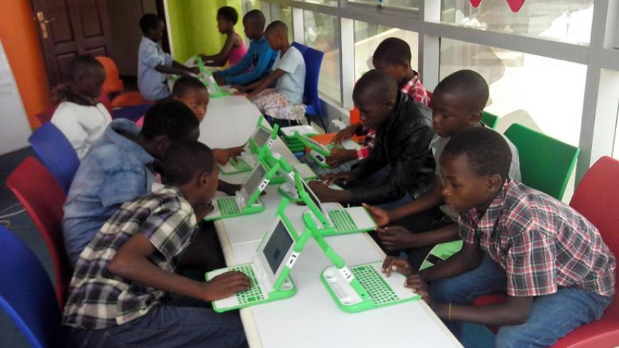 Children share computer skills and learn from one another. Teamwork leads to success. (Dennis Agaba)