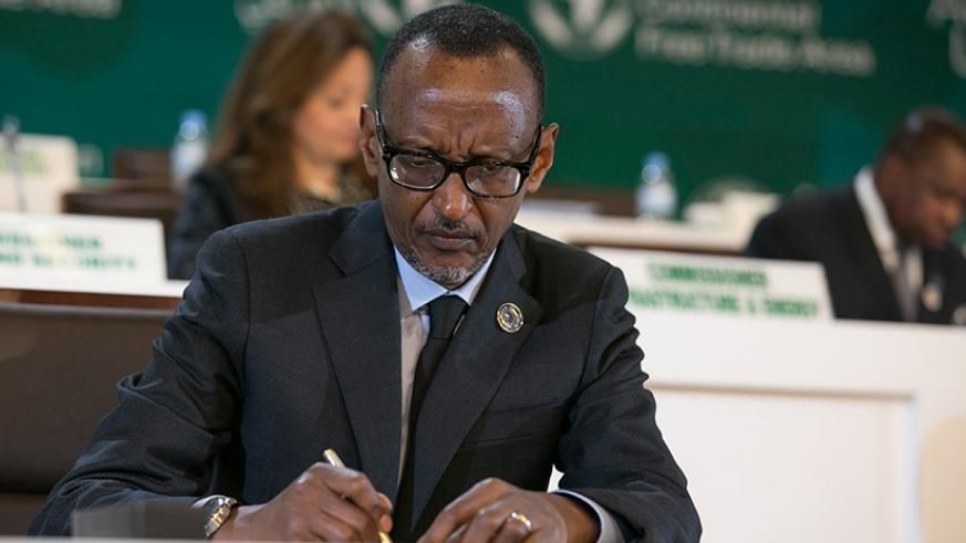President  Paul Kagame signs the three historic instruments at the 10th Extraordinary Summit of the Heads of State and Government of the African Union at the Kigali Convention Cent....