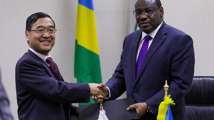 Amb. Miyashita and Minister Gatete exchange documents after signing the deal in Kigali yesterday. Timothy Kisambira.