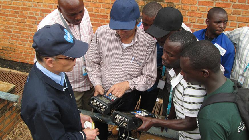 WASAC staff are learning how to use ultrasonic flow meter from JICA experts.