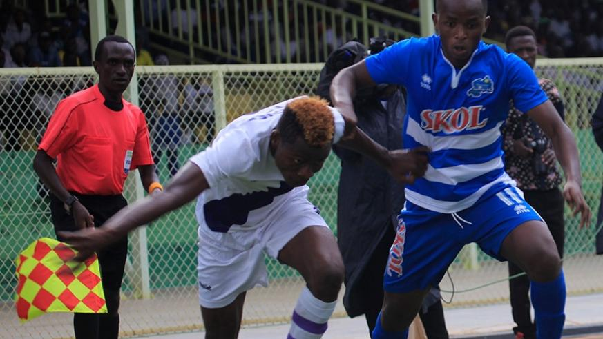 Rayon Sports forward Kevin Muhire (right) battles for possession with a Sunrise FC player during a league match last season. Sunrise host Rayon on Monday in Nyagatare. Sam Ngendahimana.