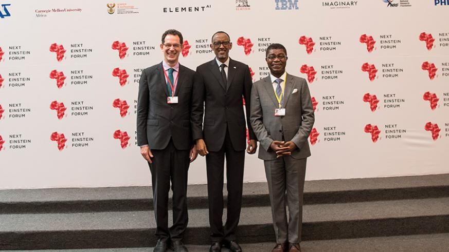 President Paul Kagame with Prof. Neil Turok, the founder of The African Institute for Mathematical Sciences (AIMS) (left) and Thierry Zomahoun, AIMS President and CEO & Next Einstein Forum founder (right), during the  official opening of the ongoing forum yesterday. / Village Urugwiro