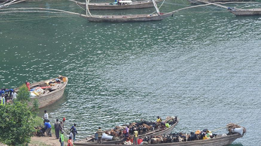 DR Congo-bound traders load livestock and other commodities on small. A plan to improve water transport has been unveiled by government. / Michel Nkurunziza.