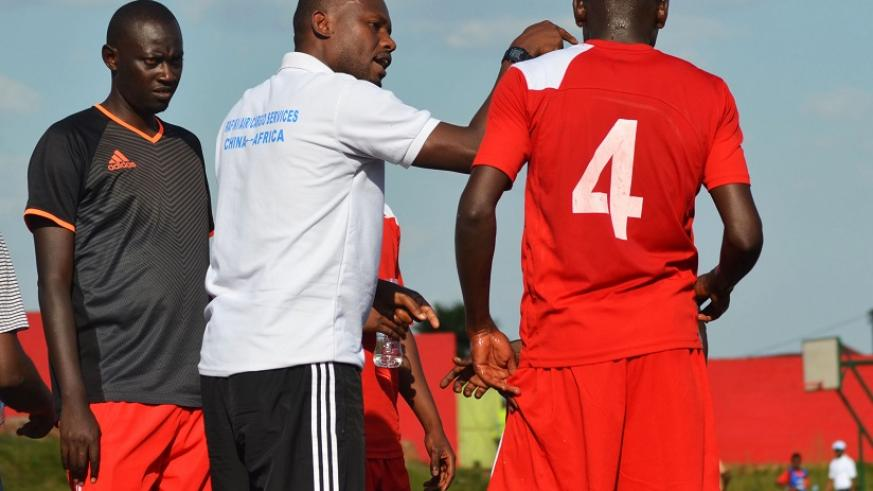 Former Rusizi based team's Head coach Jimmy Ndizeye was sacked due to his poor result, seen here in action talks to his player during the match (Sam Ngendahimana)