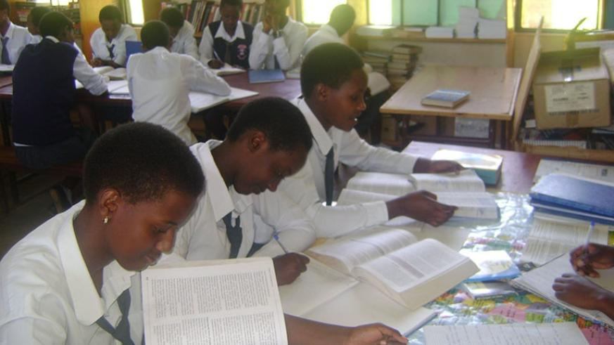 Students doing revision at school. File