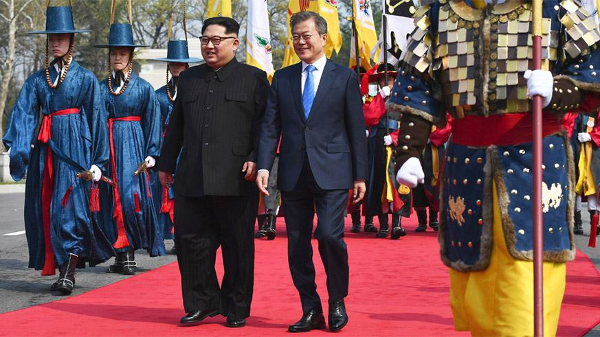 The North Korean leader, Kim Jong-un, with President Moon Jae-in of South Korea today. They were trailed by an honor guard in 19th-century uniform.