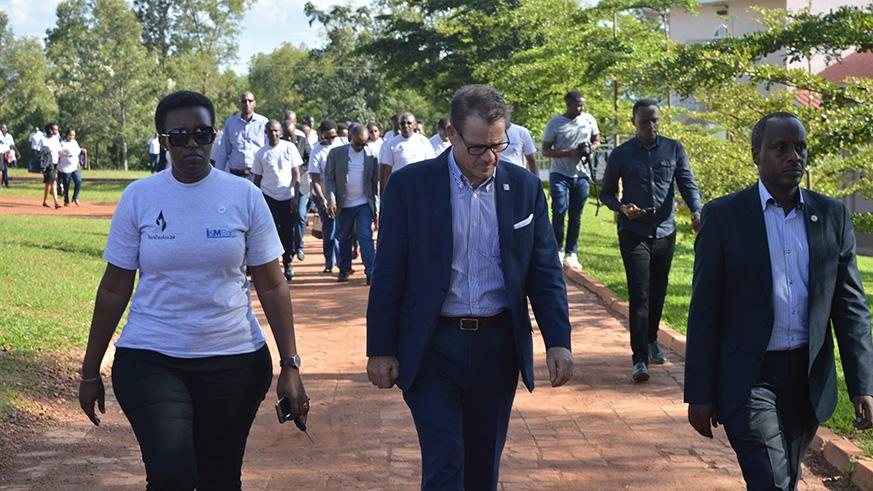 I&M staff led by the Managing Director walk to Nyanza Genocide Memorial.