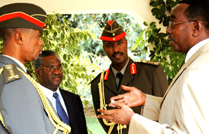 Makuza speaking to Generals, left to right, Kabarebe, Gatsinzi and Kayonga after the swearing in of a military judge and three prosecutors yesterday at the Prime Minister's office in Kimihurura, Kigali. (Photo/J. Mbanda)