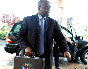 Finance Minister James Musoni arrives at Parliament to present the 2008 Budget estimates yesterday. (Photo/ G Barya)