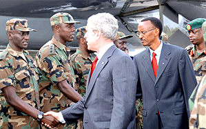 US President George W. Bush, accompanied by President Paul Kagame, greets RDF officers who have previously served in Darfur. This was during the former's visit to Rwanda last month. (File Photo)