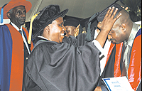 Dr Gahakwa confers a Masters degree upon a graduand yesterday, while Prof. Karangwa looks on. (Photo/G. Barya)