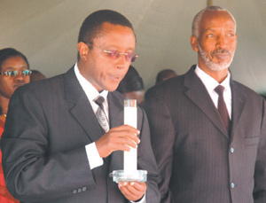 Dr Biruta blows a candle yesterday at Rebero Genocide memorial site marking the end of the official national mourning week for the victims of the 1994 Genocide. left is Francois Ngarambe. (Photo/G. Barya)