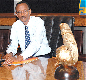 President Kagame after receiving the award (pictured) in the Cabinet meeting hall at Village Urugwiro yesterday.
