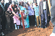Mourners during the burial of the late Police Constable Munyantamati in Masaka, a city.