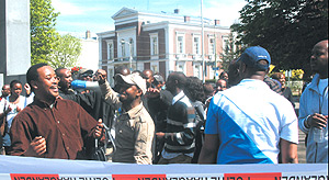 Rwandans living in The Nethelands demostrate outside the Peace Palace hall in The Hague after they were denied entry into a conference for allegedly being Tutsi.