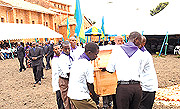 Carrying the remains of victims of the Genocide for proper burial.