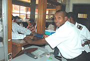 Rwanda Revenue Authority staff  attending to tax payers. (File photo) .