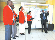 stockbrokers at  Rwanda Over-The-Counter (OTC) market. (Photo / E. Mucunguzi).