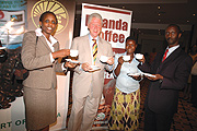Bill Clinton (C) with the State Minister of Agriculture, Agnes Kalibata (L) taste the aroma of Rwanda Coffee. (File photo)