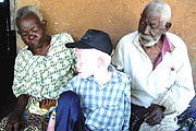NO NEED TO DISCRIMATE: Albino boy enjoys time with older relatives.