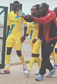 Atraco's Emmanuel Ruremesha gives a few tips to his players shortly before the Rayon Sport game. Atraco lost the encounter 3-0 before bouncing back to win last Sunday's tie. (File Photo)