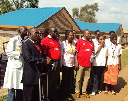 Members of GCAP pose for a group photo with hospital staff (Photo; P. Ntambara)
