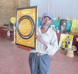 Abdul Niyonemera displays his winning art piece during the provincial level contest