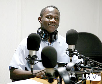Cross Fire host Eugene Anangwe in the Contact FM radio studio. The New Times/Courtesy.